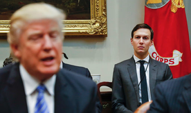 FILE - In this Monday, Jan. 23, 2017, file photo, White House Senior Adviser Jared Kushner, right, listens to President Donald Trump speak during a breakfast with business leaders in the Roosevelt Room of the White House in Washington. Trump is set to announce a new White House office run by his son-in-law, Kushner, that will seek to overhaul government functions using ideas from the business sector. (AP Photo/Pablo Martinez Monsivais, File)