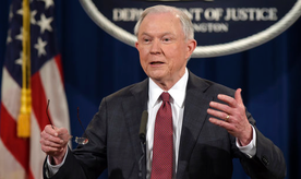 """FILE - In this March 2, 2017, file photo, Attorney General Jeff Sessions speaks during a news conference at the Justice Department in Washington. City leaders across the U.S. are vowing to intensify their fight against President Donald Trump's promised crackdown on so-called """"sanctuary cities"""" despite the financial risks. Defiance that filled a New York City gathering of municipal officials from urban centers clashed Monday, March 27, with pointed warnings from the White House's West Wing, where Sessions issued a dire warning to urban leaders. (AP Photo/Susan Walsh, File)"""