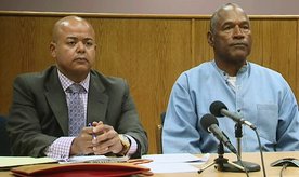 Former NFL football star O.J. Simpson appears with his attorney, Malcolm LaVergne, left, via video for his parole hearing at the Lovelock Correctional Center in Lovelock, Nev., on Thursday, July 20, 2017.  Simpson was convicted in 2008 of enlisting some men he barely knew, including two who had guns, to retrieve from two sports collectibles sellers some items that Simpson said were stolen from him a decade earlier. (Lovelock Correctional Center via AP)