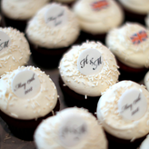The Georgetown Cupcake bakery plans commemorative cupcakes they'll be selling in honor of the upcoming royal wedding between Britain's Prince Harry and his fiancee Meghan Markle, at her shop in Washington, U.S. May 4, 2018. Picture taken May 4, 2018. REUTERS/Jonathan Ernst - RC1B391B3E00