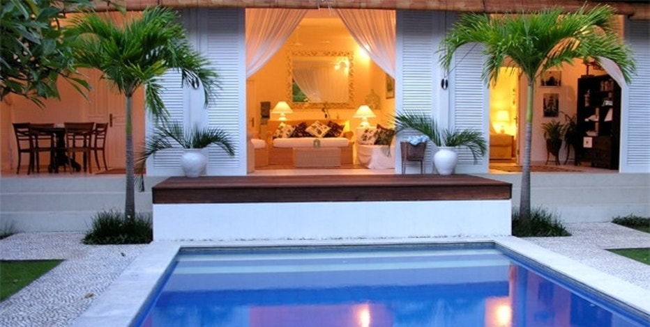 According to their listing on LuxeHomeSwap.com, the owners of this tropical Bali home are looking to trade for a home in France, Switzerland or Italy.