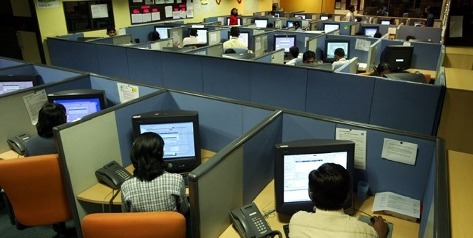 Indian employees at a call centre provide service support to international customers, in the southern city of Bangalore March 17, 2004. The hiring frenzy at call centres in India is the flip side of daily tales pouring out of the US and Britain, where thousands of software and back-office jobs are being cut as companies take advantage of cheap communications offshore to drive down costs. India is the undisputed leader of emerging markets to which developed economies are outsourcing high-technology jobs, IT consultancy firm Gartner said in a report released on Wednesday. The $3.6 billion industry in India is seen rocketing to 13.8 billion by 2007 with the number of jobs quadrupling to 1 million. Picture taken March 17, 2004. REUTERS/Sherwin Crasto  SC/