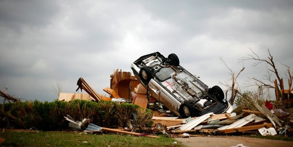 A car lies on its back, overturned by a tornado that struck Joplin, Missouri.