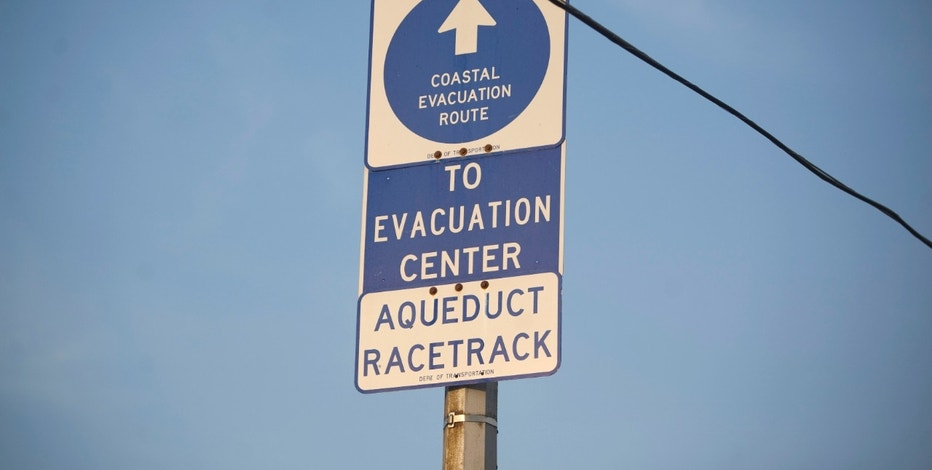 "The ""Coastal Evacuation Route"" sign is seen in Rockaway, New York, August 26, 2011. New York City on Friday ordered the evacuation of more than 250,000 people and prepared to shut down its entire mass transit system, both unprecedented measures ahead of the expected battering from Hurricane Irene. The powerful and unusually large storm trudged up the U.S. East Coast on Friday, threatening 55 million people including more than 8 million in New York City, which was expecting heavy winds late on Saturday or early on Sunday. REUTERS/Allison Joyce (UNITED STATES - Tags: ENVIRONMENT DISASTER)"