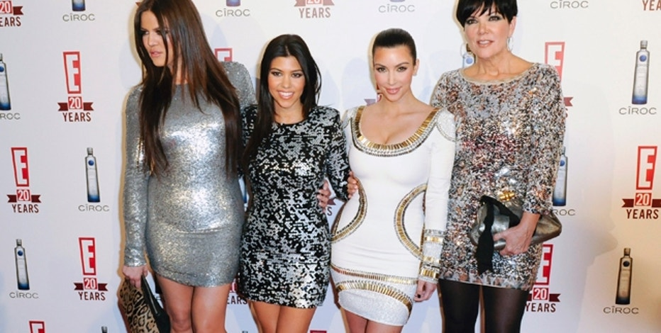 Sisters Khloe Kardashian, Kourtney Kardashian, Kim Kardashian and mother Kris Jenner (L-R) arrive at the E! 20th Birthday Celebrating Two Decades of Pop Culture, in West Hollywood, California, May 24, 2010. REUTERS/Gus Ruelas (UNITED STATES - Tags: ENTERTAINMENT PROFILE)