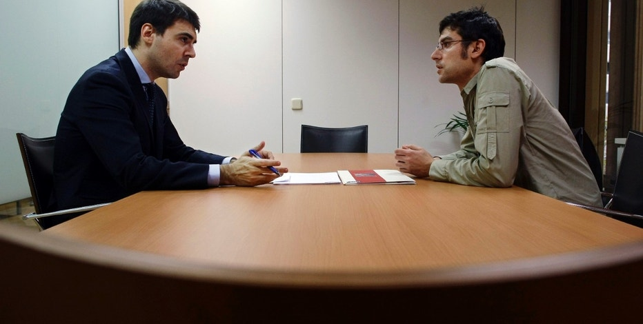 Hays Recruitment Consultancy Section Manager Ignacio Ramos (L) interviews Vicente Balmaseda at the Hays offices in downtown Madrid December 5, 2008. Balmaseda, 36, lost his job as a conference stand designer six months ago. Tensions mounting between native job-seekers and immigrants competing for a declining pool of work in Spain will intensify in 2009 as generous benefits for those laid off reach the end of their fixed terms. Picture taken December 5, 2008. To match feature SPAIN-JOBLESS/ REUTERS/Susana Vera (SPAIN)