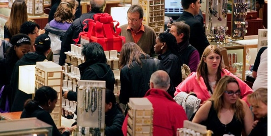 Macy's aisles are crowded with shoppers on Black Friday — called that because the surge of shoppers could take retailers into profitability, on Friday, Nov. 26, 2010, in Manhattan, New York.  (AP Photo/Bebeto Matthews)