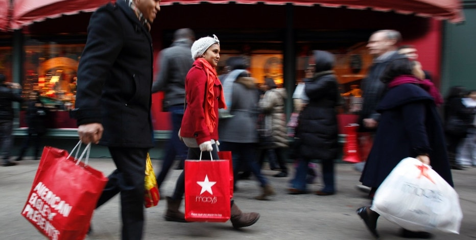 In this Dec. 18, 2010 photo, shoppers are photographed on 34th Street, in New York. Holiday shoppers are racing to the end of the season at a more feverish pace this year, with retail revenue up 5.5 percent during the last weekend before Christmas. (AP Photo/Mary Altaffer)
