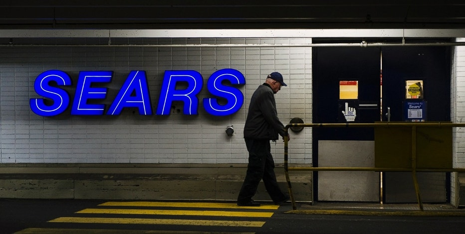 A customers enters the Sears store in North Vancouver, British Columbia February 23, 2011. Retailer Sears Canada Inc posted a 28 percent drop in its quarterly profit,  hurt in part by lower demand for appliances.  REUTERS/Andy Clark    (CANADA - Tags: BUSINESS)