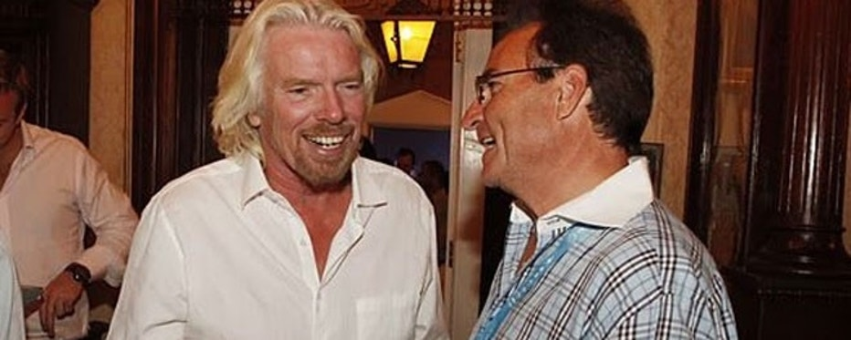 Craig Curran (right), pictured here with billionaire business magnate Richard Branson (left), is one of Virgin Galactic's accredited space agents.