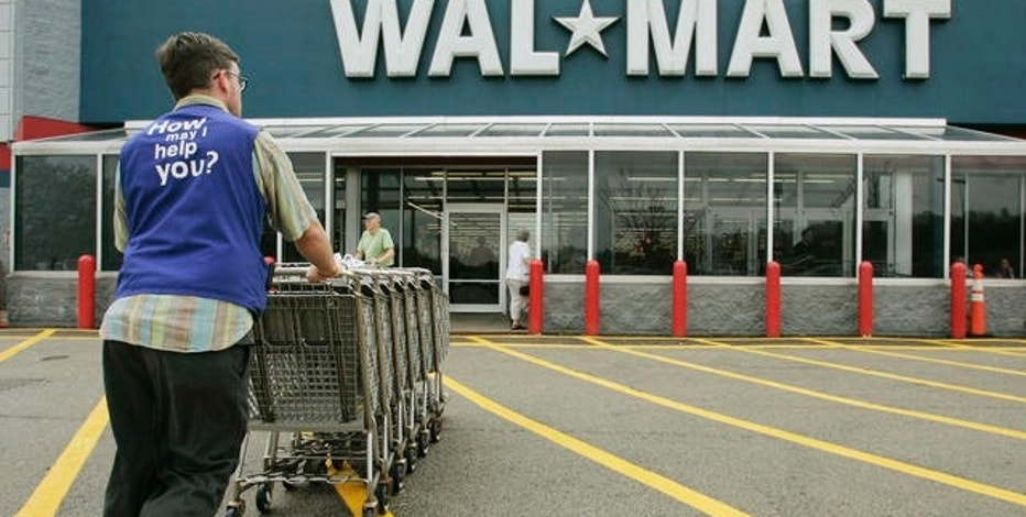 A Wal-Mart employee pushes a line of shopping carts toward the entrance of a Wal-Mart store, in Walpole, Mass., Friday, May 11, 2007. As retailers released their April sales figures, Wal-Mart Stores Inc. recorded a rare drop, the weakest performance since the world's largest retailer began publishing monthly sales in 1980, according to John Simley, a company spokesman. (AP Photo/Steven Senne)
