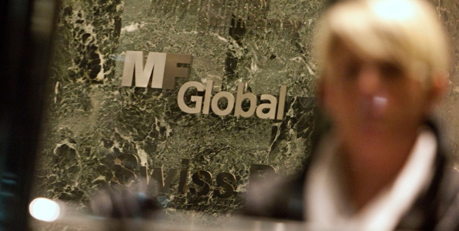 A woman leaves the office complex where MF Global Holdings Ltd have an office on 52nd Street in midtown Manhattan October 29, 2011. Members of MF Global Holdings Ltd's board of directors were meeting on Saturday to discuss options for the sale of the brokerage, Bloomberg News reported. The talks were said to have begun in New York to discuss apparent offers from five potential buyers of the company. REUTERS/Andrew Kelly (UNITED STATES - Tags: BUSINESS)