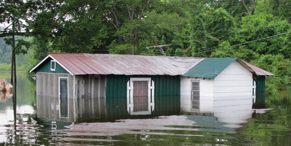 May 13: The mighty Mississippi River surrounds a house in Kings Community, Miss., after overflowing its banks.