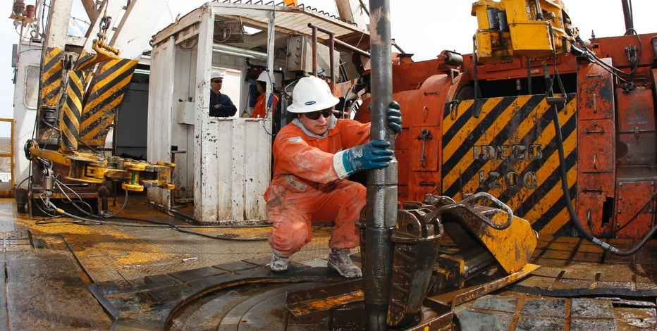 A worker manoeuvres an exploration drill bit at an oil and gas drilling rig in the Patagonian province of Neuquen October 14, 2011. Argentine energy firm YPF, the local unit of Spain's Repsol, said on November 7, 2011 it had confirmed unconventional oil resources of 927 million barrels of oil equivalent in Patagonia. The resources lie in a 428 kilometre square area in the southern province of Neuquen, where the company announced a large unconventional natural gas find nearly a year ago. 