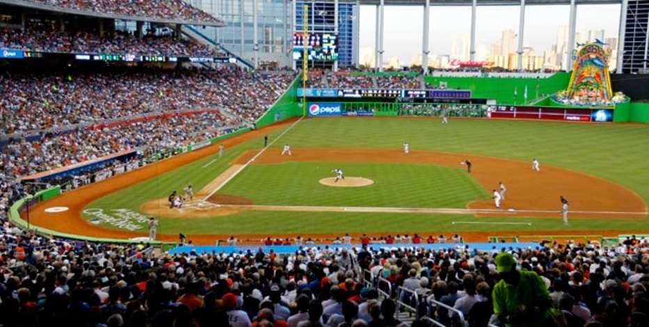 The Miami Marlins (on the field) face the St. Louis Cardinals in the first inning during their season-opening MLB baseball game in Miami, Florida April 4, 2012.