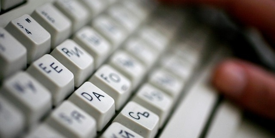 An employee types on a computer keyboard with both Latin and Cyrillic letters in Sofia June 23, 2008. Bulgaria applied on Monday to register an Internet domain name in Cyrillic script as part of efforts to boost national pride amid a growing influence of English.    REUTERS/Stoyan Nenov   (BULGARIA)