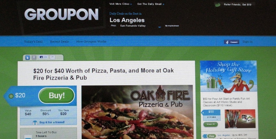 An online coupon sent via email from Groupon is pictured on a laptop screen November 29, 2010 in Los Angeles. Google Inc  is reportedly closing in on a deal to buy online discount-coupon sensation Groupon for up to $6 billion in its largest-ever acquisition, signaling a willingness to use some of its huge cash hoard to buy growth. REUTERS/Fred Prouser  (UNITED STATES - Tags: BUSINESS SCI TECH)
