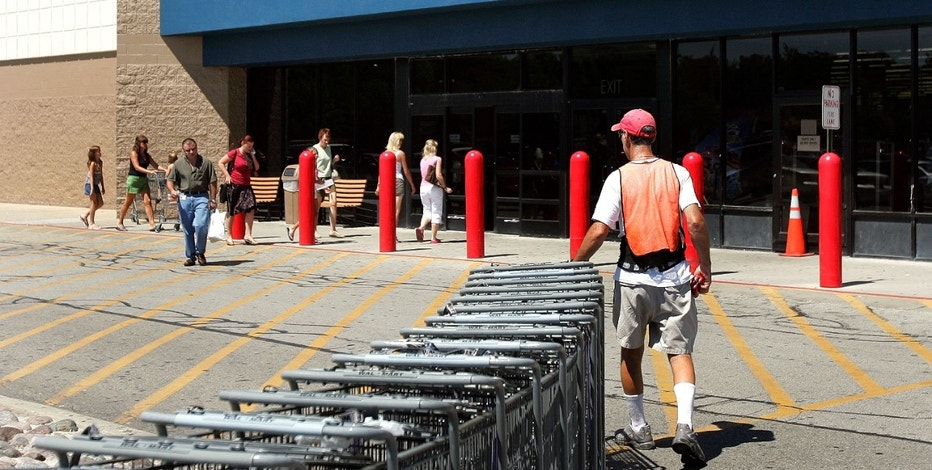 MOUNT PROSPECT, IL - AUGUST 15:  A worker collects shopping carts outside a Wal-Mart store August 15, 2006 in Mount Prospect, Illinois. Wal-Mart profits fell 26 percent for the quarter, the first time the mega-retail giant posted a decline in profits in 10 years.  (Photo by Tim Boyle/Getty Images)