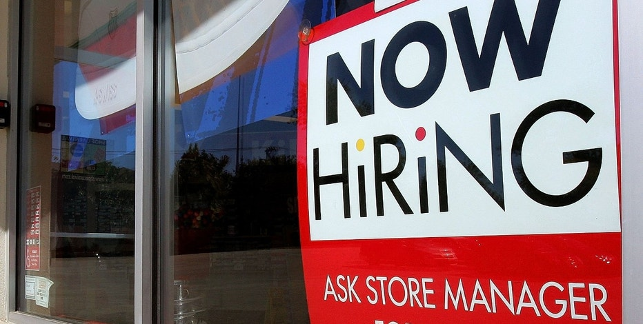 "MORTON GROVE, IL - OCTOBER 06:  A man enters a Shoe Carnival store beyond a ""Now Hiring"" sign in a window October 6, 2006 in Morton Grove, Illinois. The U.S. Department of Labor's monthly employment report released today shows a dip in both job growth and the unemployment rate in September.  (Photo by Tim Boyle/Getty Images)"