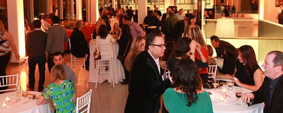 Guests mingle at a reception at Maserati of Long Island.