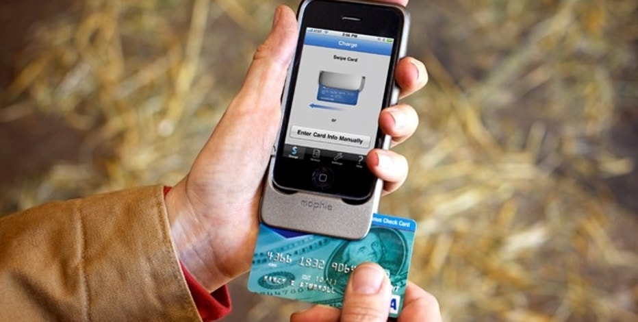 The Mophie readers turns a smartphone take credit card payments, one of several ways to replace wallets with smartphones.