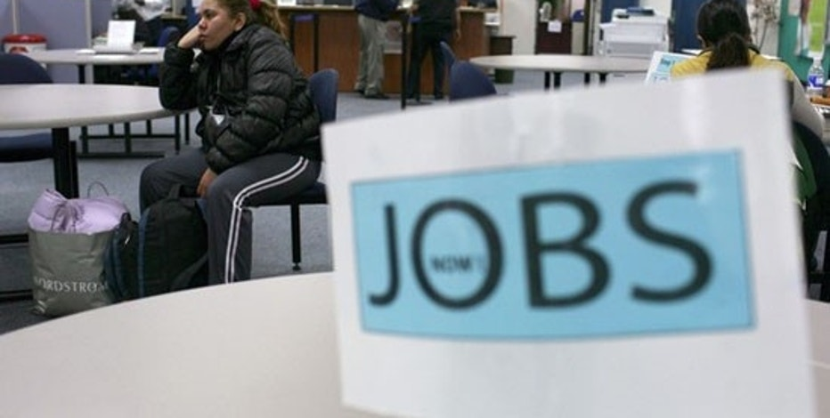 Job seekers visit an employment center in San Francisco, California in this November 20, 2009 file photo.  U.S. employers cut only 11,000 jobs last month, the best showing in nearly two years, and the jobless rate edged down to 10 percent, a strong suggestion the jobs market was edging towards health, according to a U.S. Labor Department report issued on December 4, 2009. Picture taken November 20, 2009.   REUTERS/Robert Galbraith  (UNITED STATES BUSINESS EMPLOYMENT)