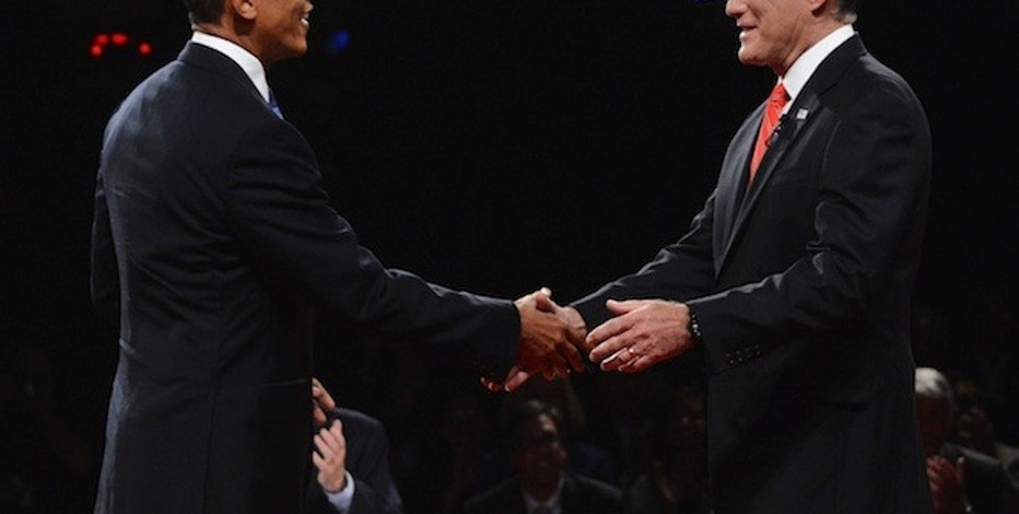 Republican presidential nominee Mitt Romney shakes hands with President Barack Obama at the start of the first 2012 U.S. presidential debate in Denver October 3, 2012. REUTERS/Michael Reynolds/Pool  (UNITED STATES - Tags: POLITICS ELECTIONS USA PRESIDENTIAL ELECTION)