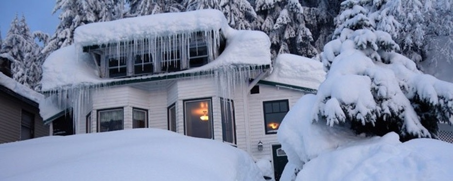 In this Saturday, Jan. 7, 2012 photo provided by the Alaska Division of Homeland Security and Emergency Management, a house is buried in snow in the fishing town of Cordova, Alaska. Residents have turned to the state to help them dig out of massive snow levels that have collapsed roofs, triggered avalanches and even covered doors, trapping some people in their homes. (AP Photo/Alaska Division of Homeland Security and Emergency Management, Erv Petty)