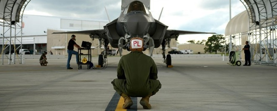 Mechanic Sgt. Stephen Fink watches a F-35B Lightning II joint strike fighter from the Marine Fighter Attack Training Squadron 501, at Eglin Air Force Base, Florida, in this Sept. 18, 2012, handout photo courtesy of the U.S. Marine Corps.