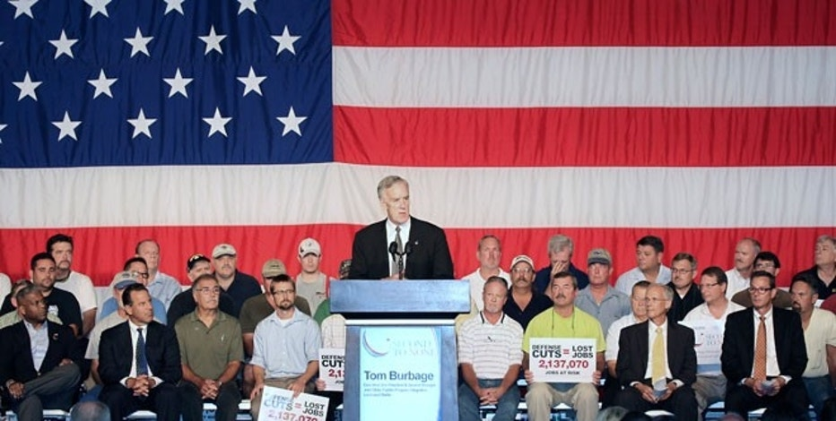 Tom Burbage, executive vice president and general manager for Joint Strike Fighter Program Integration at Lockheed Martin, speaks to Pratt and Whitney employees at a rally to call to attention upcoming defense budget cuts in West Palm Beach, Florida, on Aug. 8, 2012.