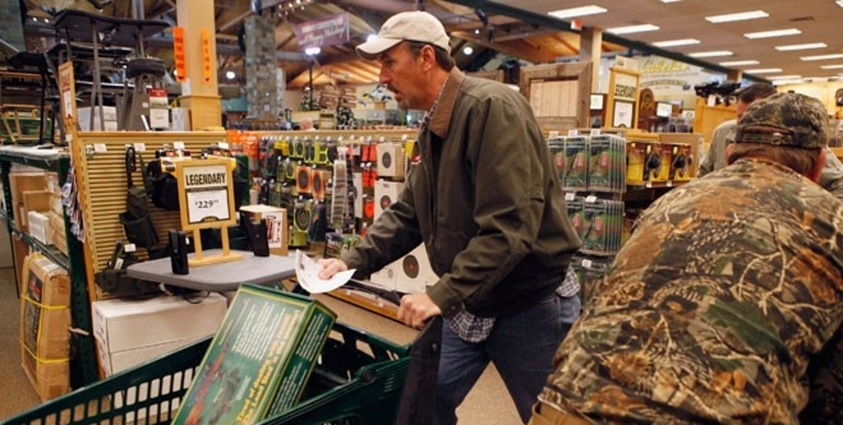 "Shoppers rush to grab items inside a Cabela's store on the shopping day dubbed ""Black Friday"" in Fort Worth, Texas."