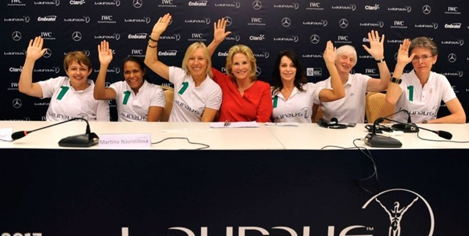 "The 2013 Laureus World Sports Awards' ""Women in Sport"" press conference and panel discussion were held on Monday, March 11, in Rio de Janeiro, gathering esteemed speakers and more than 100 participants. Pictured left to right are the panelists and moderator acknowledging the statement, ""Raise your hands if you believe in the power of women:"" Tanni Grey-Thompson, Cathy Freeman, Martina Navratilova, Donna de Varona (panel moderator), Nadia Comăneci, Sue Campbell and Beth Brooke"