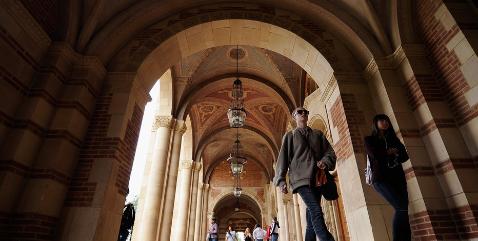 LOS ANGELES, CA - APRIL 23:  Students walk near Royce Hall on the campus of UCLA on April 23, 2012 in Los Angeles, California. According to reports, half of recent college graduates with bachelor's degrees are finding themselves underemployed or jobless.  (Photo by Kevork Djansezian/Getty Images)