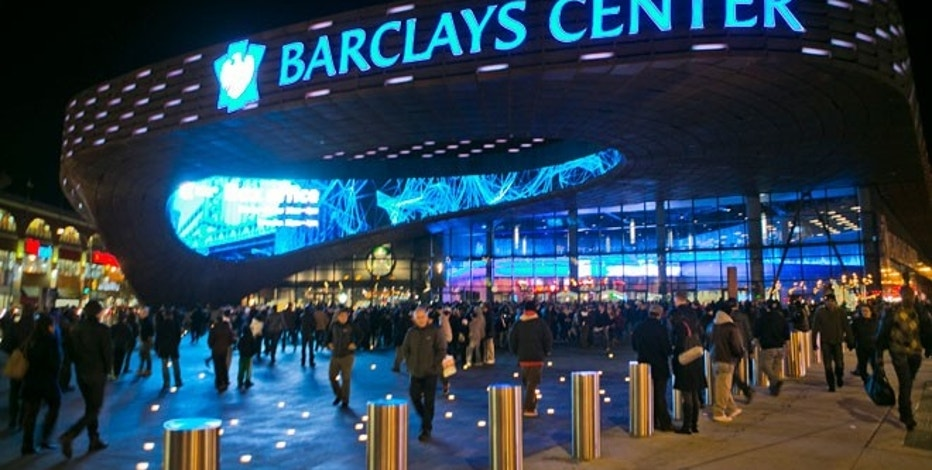 Crowds arrive outside the Barclays Center before the Brooklyn Nets played the Toronto Raptors in their first NBA basketball game in their new arena in Brooklyn, New York.