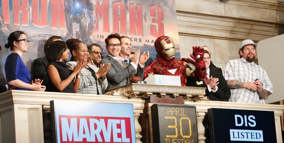 Actor Robert Downey Jr. (C) and Marvel Comics representatives ring the opening bell at the New York Stock Exchange to promote his new movie 'Iron Man 3,' April 30, 2013. Marvel Comic's 'Iron Man 3,' opens in the U.S. on May 3, 2013. REUTERS/Brendan McDermid (UNITED STATES - Tags: BUSINESS ENTERTAINMENT) - RTXZ4Y5