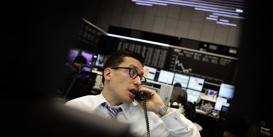 A share trader reacts during the morning trading session at Frankfurt's stock exchange December 12, 2011.  REUTERS/Kai Pfaffenbach (GERMANY - Tags: BUSINESS POLITICS)