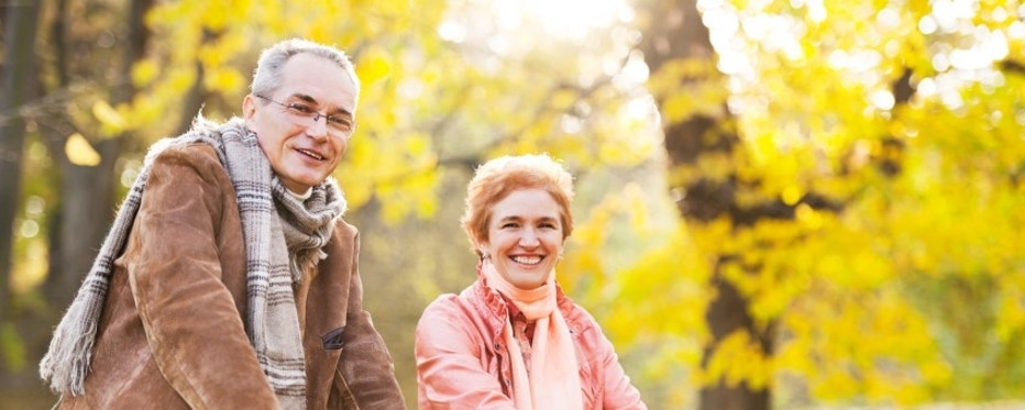 Cheerful mature adults enjoying in the autumn while riding bicycles. [url=http://www.istockphoto.com/search/lightbox/9786786][img]http://dl.dropbox.com/u/40117171/couples.jpg[/img][/url]