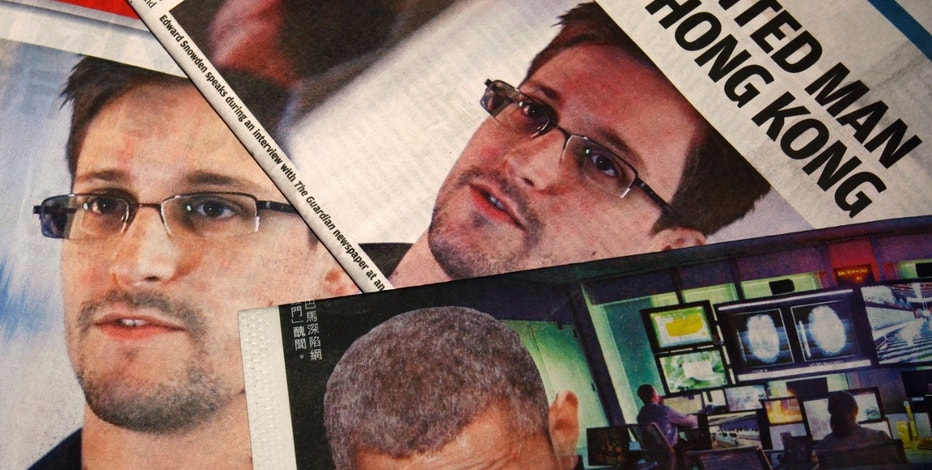 Photos of Edward Snowden, a contractor at the National Security Agency (NSA), and U.S. President Barack Obama are printed on the front pages of local English and Chinese newspapers in Hong Kong in this illustration photo June 11, 2013. Snowden, who leaked details of top-secret U.S. surveillance programs, dropped out of sight in Hong Kong on Monday ahead of a likely push by the U.S. government to have him sent back to the United States to face charges. REUTERS/Bobby Yip (CHINA - Tags: POLITICS MEDIA) - RTX10JI6