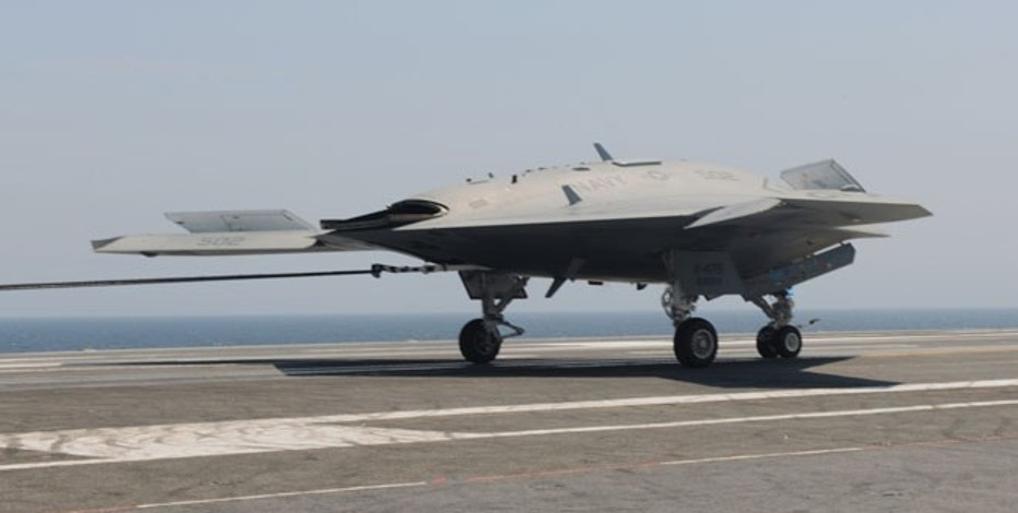 The X-47B lands aboard USS George H.W. Bush (CVN 77) July 10, marking the first time an unmanned aircraft has made an arrested landing on a modern aircraft carrier.