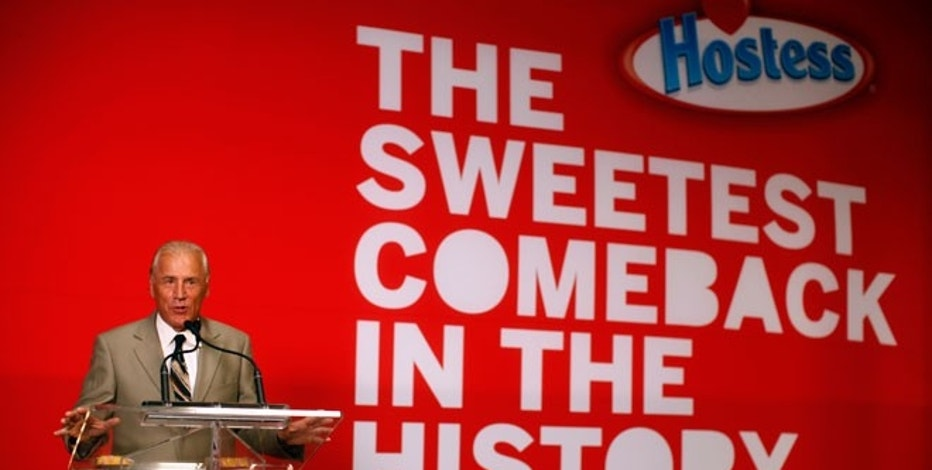 CEO of Hostess Brands Dean Metropoulos speaks at a ceremony marking the return of Twinkies at a plant in Schiller Park, Illinois.