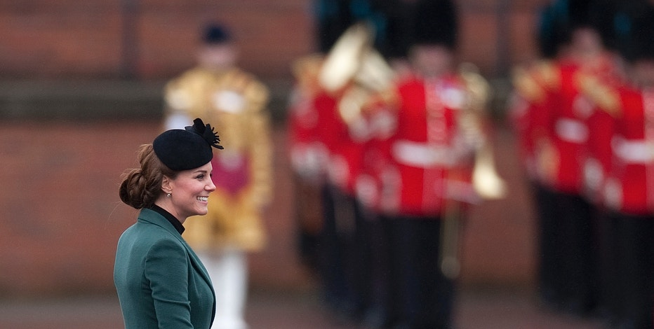 Britain's Catherine, Duchess of Cambridge smiles during a visit with her husband, Prince William, to attend a St Patrick's Day Parade at Mons Barracks in Aldershot, southern England March 17, 2013. REUTERS/Kieran Doherty (BRITAIN - Tags: ANNIVERSARY ENTERTAINMENT MILITARY SOCIETY ROYALS)