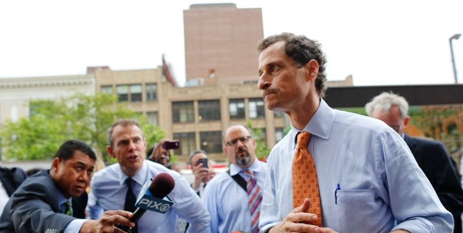 Former U.S. Congressman and New York City mayoral candidate Anthony Weiner speaks with reporters at campaign event in New York, May 23, 2013.  Weiner, who resigned two years ago after posting a lewd photo online, began his campaign for New York City mayor Thursday. REUTERS/Brendan McDermid (UNITED STATES - Tags: POLITICS ELECTIONS)