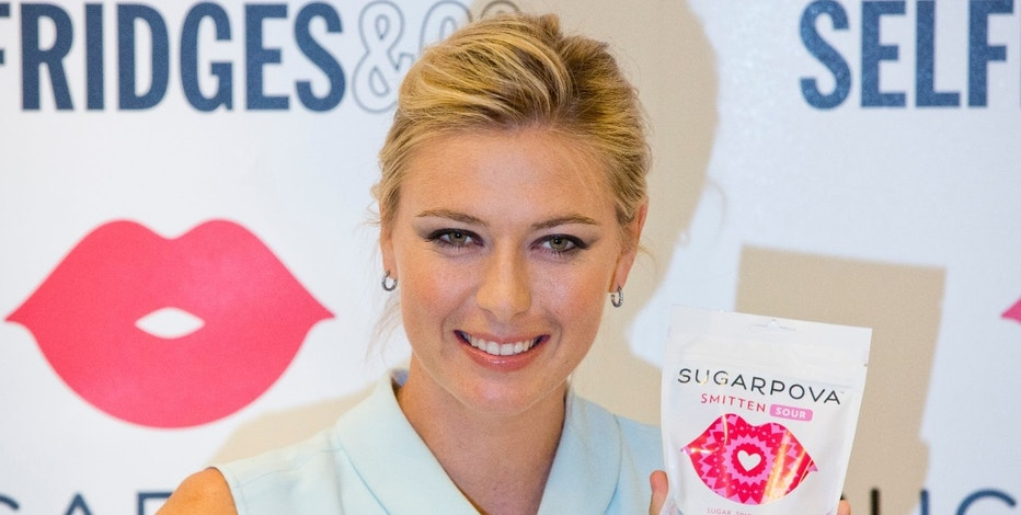 "Tennis player Maria Sharapova  poses for photographers as she promotes her ""Sugarpova"" confectionary brand in London June 20, 2013. REUTERS/Neil Hall (BRITAIN - Tags: BUSINESS FOOD SPORT TENNIS) - RTX10V59"