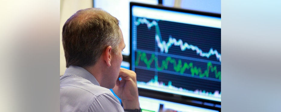 A trader looks at his screen on the floor of the New York Stock Exchange June 29, 2010. Investors fled the U.S. stock market on Tuesday and the S&P 500 tumbled to its lowest level in eight months in a sell-off triggered by a wave of increasing alarm over the global economic outlook. REUTERS/Brendan McDermid (UNITED STATES - Tags: BUSINESS)
