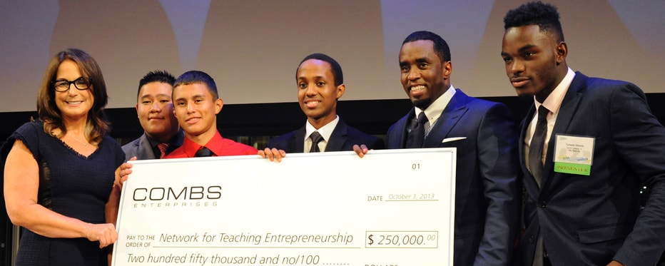 P.D Ditty presents check to NFTE at the NY Times Center.