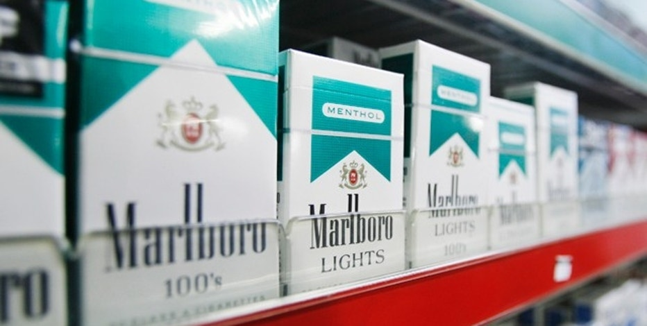 Cigarettes are be seen in a tobacco shop in New York April 1, 2009.  REUTERS/Lucas Jackson (UNITED STATES BUSINESS HEALTH POLITICS)