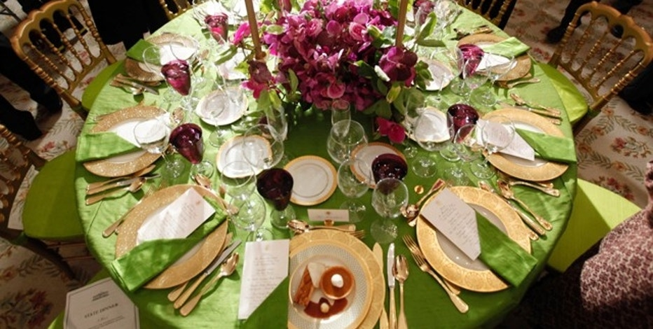 An example of table setting is seen on display at a State Dinner preview event at the White House in Washington, November 24, 2009. U.S. President Barack Obama will hold a State Dinner in honor of Indian Prime Minister Manmohan Singh later in the evening.    REUTERS/Jim Young   (UNITED STATES POLITICS FOOD)