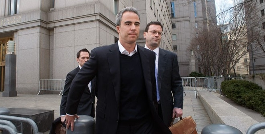 Michael Steinberg (C) leaves Manhattan Federal Court in New York March 29, 2013.