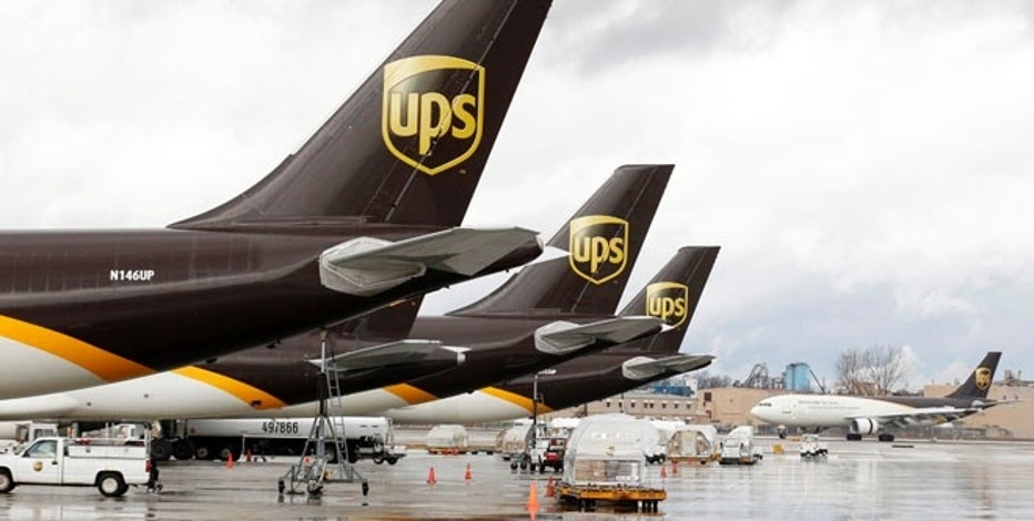 United Parcel Service aircrafts are being loaded with air containers full of packages bound for their final destination at the UPS Worldport All Points International Hub during the peak delivery day in Louisville, Kentucky, December 20, 2012. The company expects to deliver more than 28 million air and ground packages globally today, of which more than 4 million will be moving through the Louisville hub. This year, UPS expects to deliver more than 450 million packages globally during the time between Thanksgiving and Christmas. REUTERS/John Sommers II (UNITED STATES - Tags: BUSINESS TRANSPORT) - RTR3BSNA