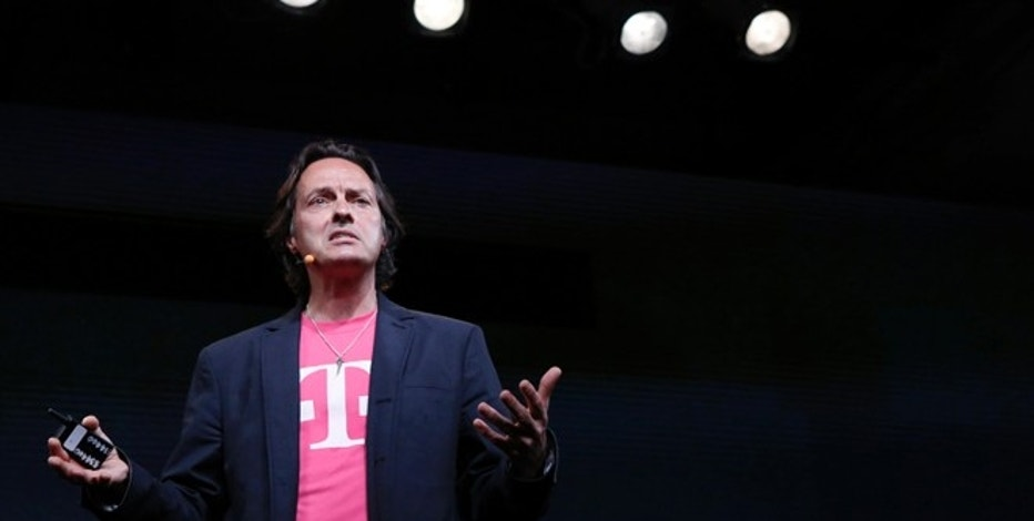 T-Mobile Chief Executive John Legere speaks during a company event in New York July 10, 2013. REUTERS/Brendan McDermid (UNITED STATES - Tags: BUSINESS TELECOMS)
